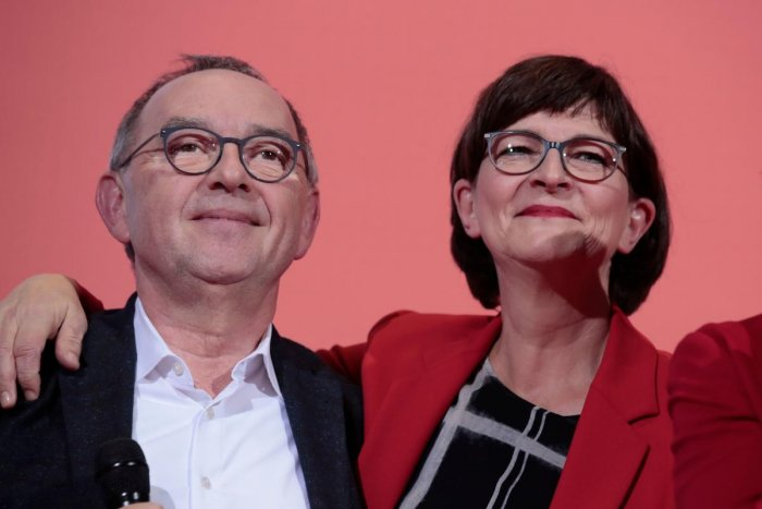 Newly elected co-leaders of Germany's Social Democratic Party (SPD) Saskia Esken (R) and Norbert Walter-Borjans celebrate on stage after the results of the vote for the SPD leadership at the Willy-Brandt Haus, the Social Democrats Party headquarters in Be