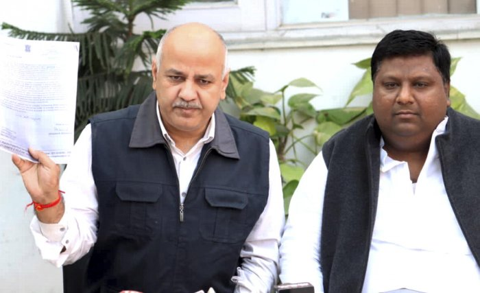 Delhi Deputy Chief Minister Manish Sisodia addresses a press conference as Delhi Food and Civil Supplies Minister Imran Hussain looks on, in New Delhi. PTI photo