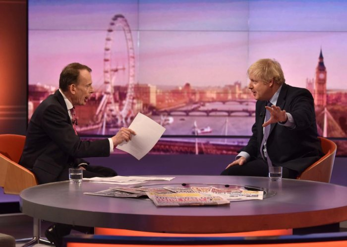 Britain's Prime Minister Boris Johnson (R) gestures as he speaks with political journalist Andrew Marr (L) during an appearance on the BBC political programme The Andrew Marr Show in London. AFP photo