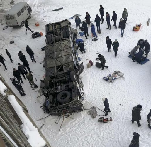 the bus after plunging from a bridge over the Kuenga River. PTI photo