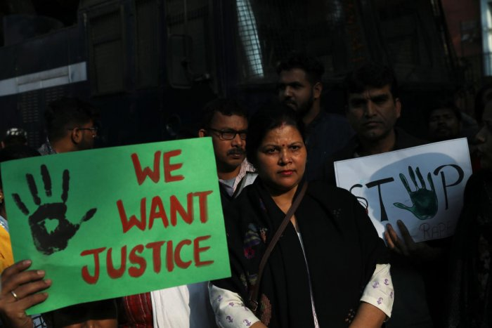 People hold placards and shout slogans as they take part in a protest against the alleged rape and murder of a 27-year-old woman on the outskirts of Hyderabad, in New Delhi, India, November 30, 2019. (Reuters photo)