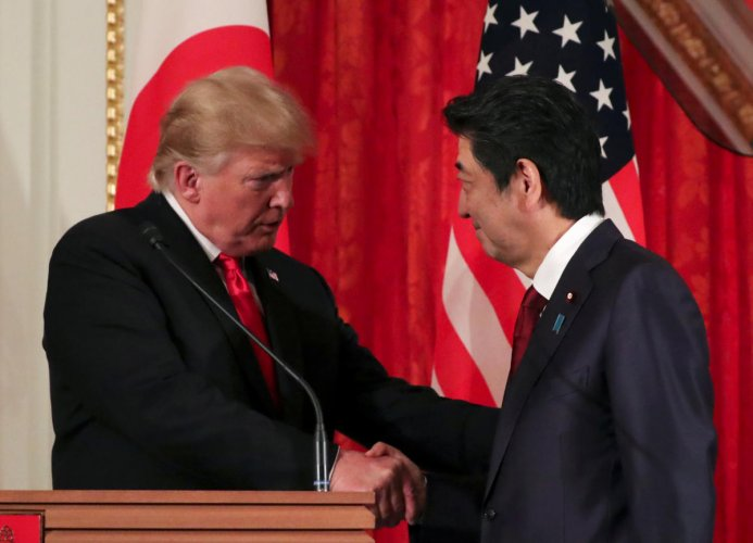 US President Donald Trump shakes hands with Japan's Prime Minister Shinzo Abe (Reuters Photo)