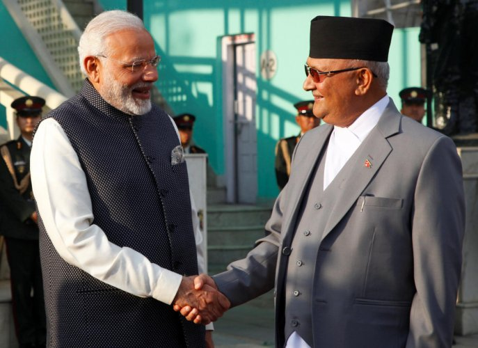 Narendra Modi shakes hand with his Nepalese counterpart Khadga Prasad Sharma Oli after inspecting a guard of honour upon his arrival in Kathmandu. Reuters file photo