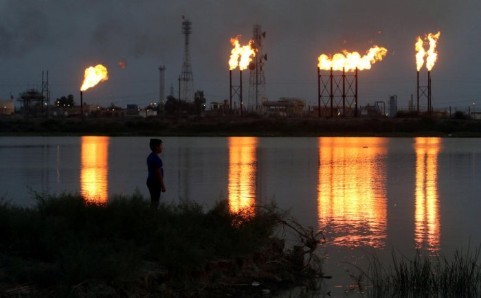 Flames emerge from flare stacks at Nahr Bin Umar oil field, north of Basra, Iraq September 16, 2019. (Reuters Photo)