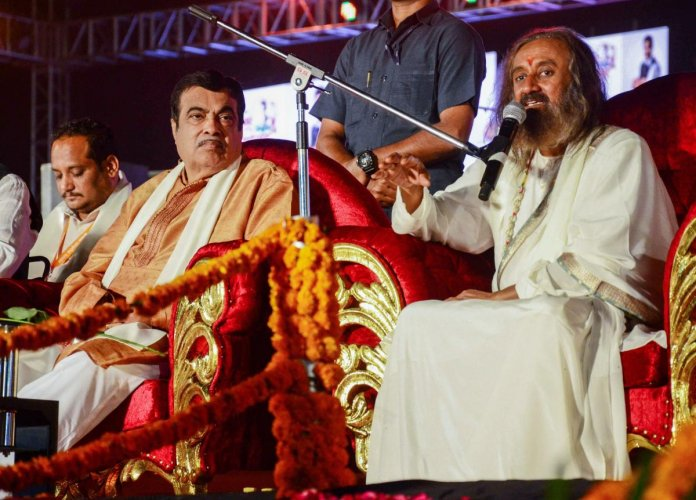 Art of Living founder Sri Sri Ravi Shankar addresses while Union Minister Nitin Gadkari looks on, at the inauguration of the first day of 'Khasdar Sanskrutik Mahotsav 2019', in Nagpur, Friday, Nov. 29, 2019. (PTI Photo)