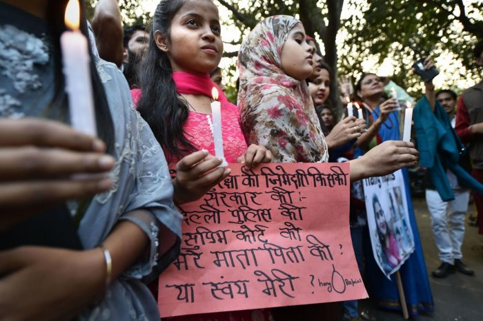 Girls along with activists take part in a candle light protest over the Hyderabad rape and murder case, in New Delhi (PTI photo)