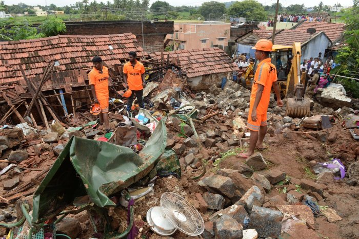 TNDRF personnel carry out rescue works at the site of the wall collapse in Nadur village of Mettupalayam taluk, near Coimbatore, Monday, Dec. 2, 2019. (PTI Photo)