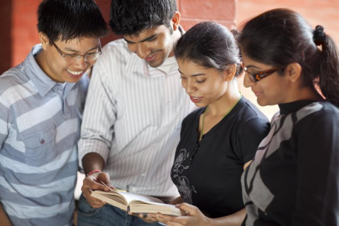 Indian Students Studying Together On CampusEducation and Youth