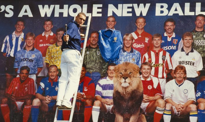 Former Wimbledon FC player Vinnie Jones, a member of the Crazy Gang, nails a Wimbledon shirt to his image on a bill board promoting the first Premier League season in July 1992. Allsport/Getty Images