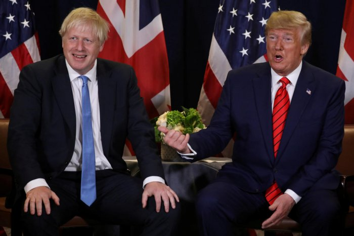 """US President Donald Trump said on Tuesday he would meet British Prime Minister Boris Johnson but promised to """"stay out"""" of Britain's election campaign during his two-day visit. Photo/REUTERS"""
