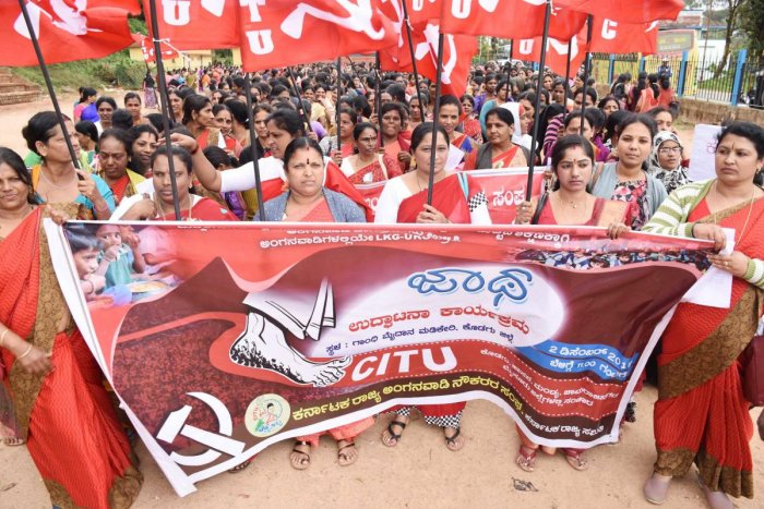 Under the aegis of CITU, anganwadi workers take out a rally in Madikeri on Monday.