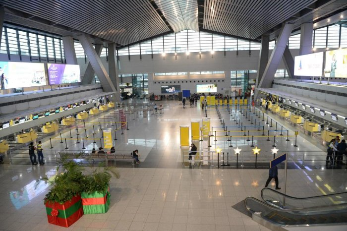 A general view of empty airline check-in counters inside the terminal three of the Manila international airport, hours before the deadline of the closure of the airport due to Typhoon Kammuri. Typhoon Kammuri lashed the Philippines with fierce winds and h