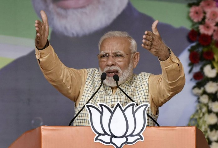 Prime Minister Narendra Modi gestures as he speaks during an election campaign at Khunti district of Jharkhand. Photo by PTI.