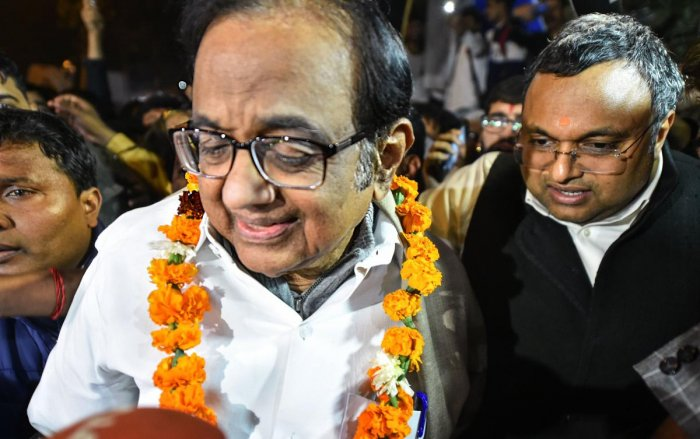 Senior Congress leader P Chidambaram being greeted by the party workers and supporters as he comes out after he was released from Tihar jail in New Delhi, Wednesday night, Dec. 4, 2019. The Supreme Court on Wednesday granted bail to Chidambaram in the INX Media money laundering case. (PTI Photo/Arun Sharma)