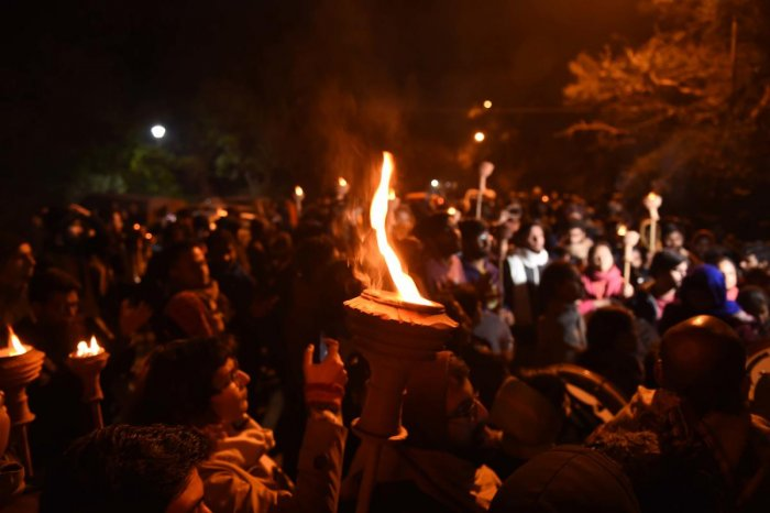 JNU students take part in a Mashal Juloos (torch light procession) to protest against the proposed fee hike and IHA mannual, on the University campus in New Delhi, Tuesday, Dec. 3, 2019. (PTI Photo/Atul Yadav)