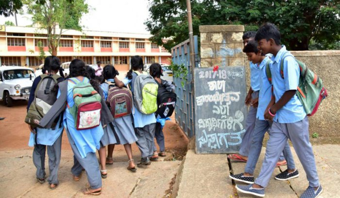 HMT Higher Kannada Primary School children are come to school on 1 st day, after the Summer vacation, schools are re-opened on Monday, in Bengaluru. Photo/ B H ShivakumarThe department of public instruction conducted various campaigns in the beginning of