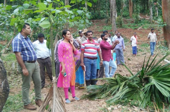 Deputy Commissioner Annies Kanmani Joy visits the site earmarked for rehabilitation of flood victims in Abhyath Mangala village in Kodagu.