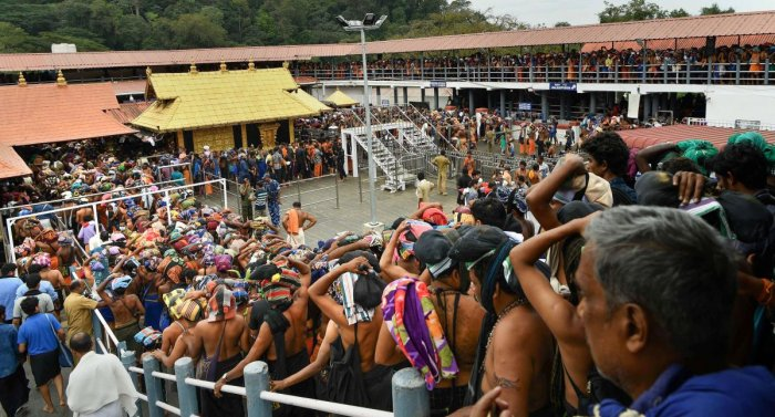 Devotees will be advised to keep their mobile phones switched off and those who use a mobile phone at the temple premises will be initially warned and stringent actions like the seizure of phones would be initiated against repeated violators, N Vasu, president of the Travancore Devaswom Board that manages the temple, told DH. Photo/PTI