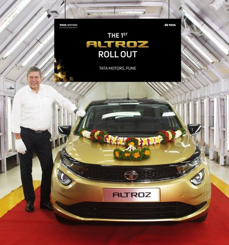 Guenter Butschek, CEO & Managing Director, Tata Motors flagging off  the first Tata Altroz from the company's plant in Pune. (DH Photo)