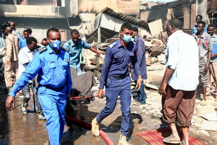 Sudanese Civil Defence transport the bodies of victims of a fire at a tile manufacturing unit in an industrial zone in north Khartoum.