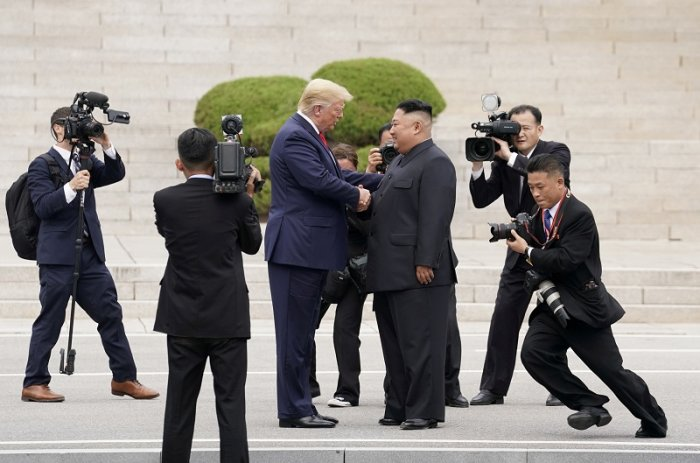 U.S. President Donald Trump meets with North Korean leader Kim Jong Un at the demilitarized zone separating the two Koreas, in Panmunjom, South Korea. (Reuters Photo)