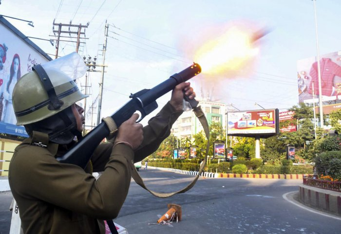 Police fire teargas shells to disperse protesters during their clashes as they march against the Citizenship (Amendment) Bill, 2019, in Guwahati. (PTI Photo)