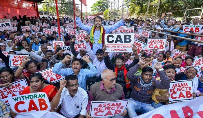 Activists of Krishak Mukti Sangram Samiti (KMSS) adviser Akhil Gogoi during a protest against the Citizenship Amendment Bill (CAB). Photo by PTI.