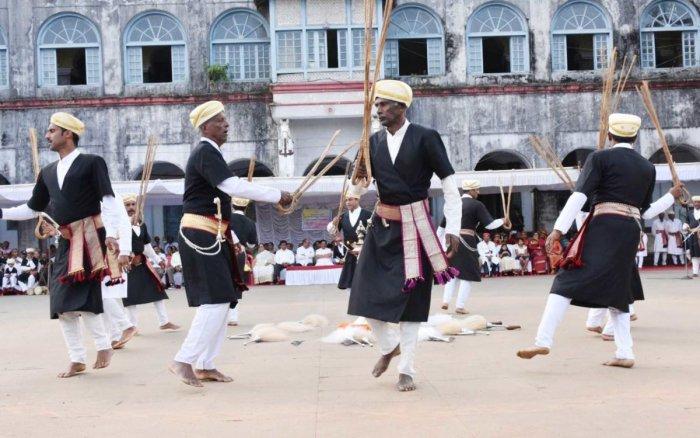 Kodava men perform 'Huthari Kolata' on the premises of the Old Fort in Madikeri on Thursday.