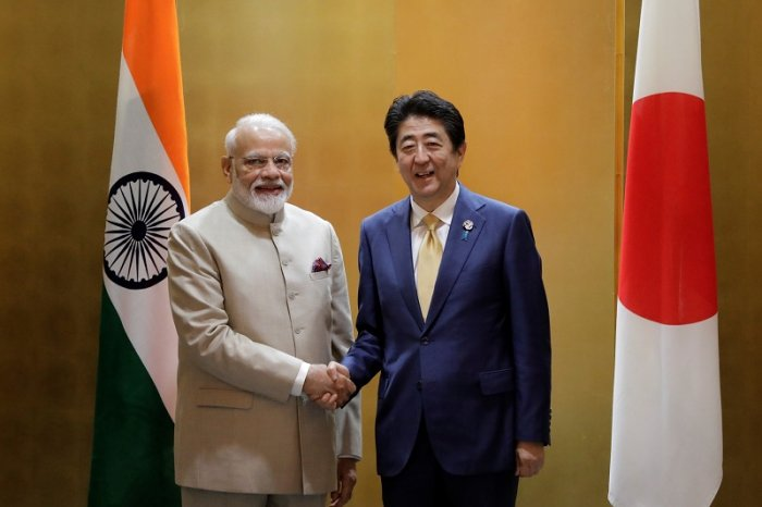 Narendra Modi, India's prime minister, shakes hands with Shinzo Abe, Japan's prime minister. (Reuters Photo)