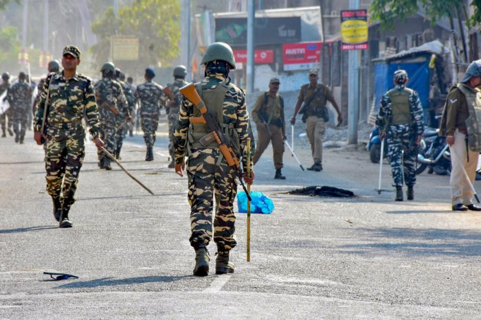 Security forces personnel patrol a street during curfew, imposed in view of various anti-CAB (Citizenship Amendment Bill) protests in Sonitpur, Assam. (PTI Photo)