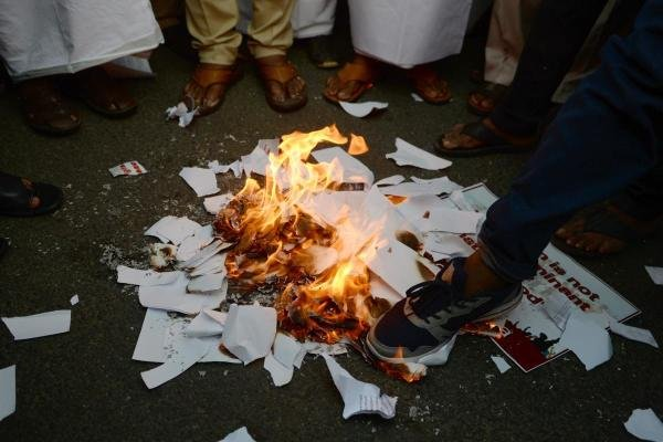 Demonstrators burns a copy of the Citizenship Amendment Bill (CAB) during a demonstration in Chennai on December 12, 2019. (AFP photo)