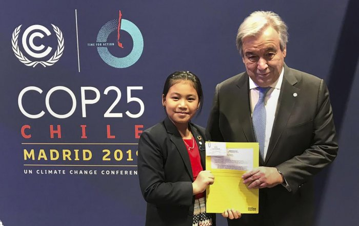 Activist Licypriya Kangujam (R) from Manipur poses for a photograph with UN chief Antonio Guterres at COP 25 in Madrid. (PTI Photo)