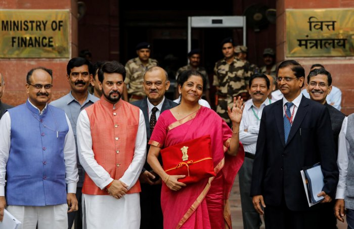 India's Finance Minister Nirmala Sitharaman (C) gestures during a photo opportunity as she leaves her office to present the federal budget in the parliament in New Delhi. PTI photo