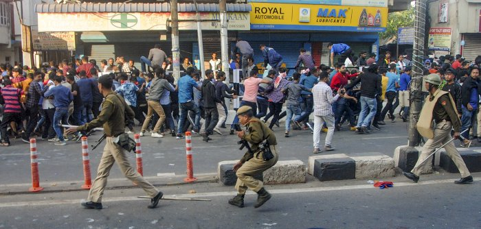 Guwahati: Police attempt to disperse protestors during anti-CAB demonstrations, in Guwahati. (PTI Photo)