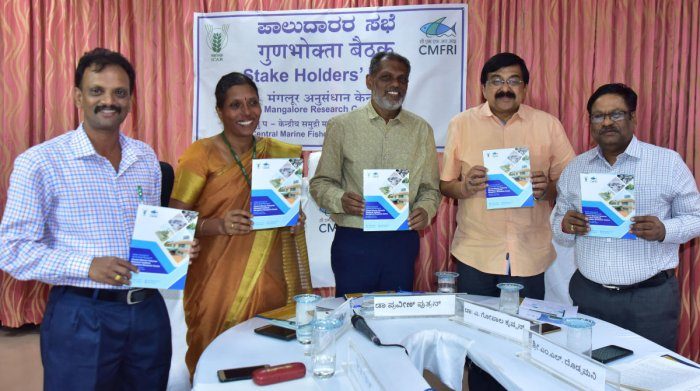 Dr Praveen Puthran, Assistant Director General (Marine Fisheries), ICAR, New Delhi, CMFRI, Kochi Director Dr Gopalakrishnan and others release a handbook on the activities of CMFRI, Mangaluru on Friday. DH Photo