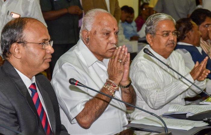 Chief Minister B S Yediyurappa at a meeting of additional chief secretaries in Vidhana Soudha on Friday. Chief Secretary to government T M Vijay Bhaskar and Deputy Chief Minister Govind Karjol are seen.