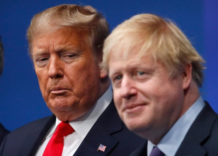 Britain's Prime Minister Boris Johnson (R) with US President Donald Trump (L). (AFP Photo)
