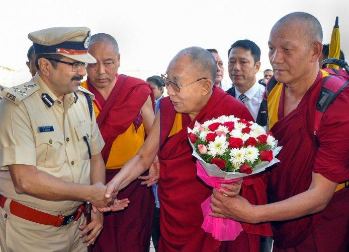 Hubballi: Tibetan spiritual leader Dalai Lama being welcomed at the airport in Hubballi, Thursday, Dec. 12, 2019. (PTI Photo)