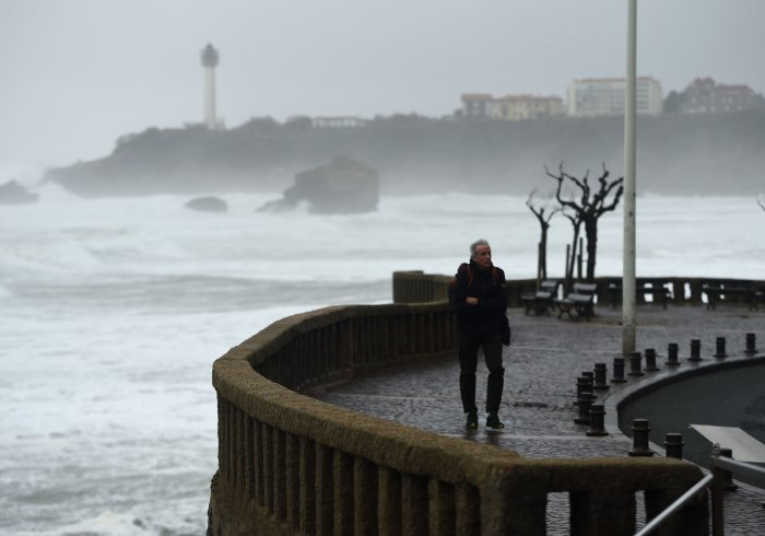 A man walks during the storm near the Grande Plage in Biarritz, southwestern France. (AFP Photo)