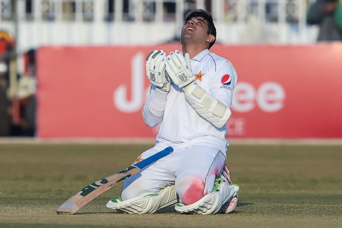 Pakistan's Abid Ali offers a prayer after scoring century (100 runs) during the fifth and final day of the first Test cricket match between Pakistan and Sri Lanka at the Rawalpindi Cricket Stadium. AFP