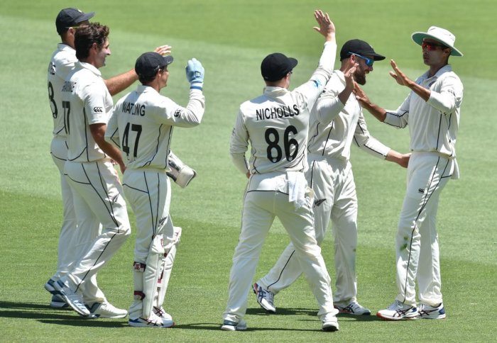 New Zealand's Jeet Raval (R) celebrates catching Australia's Matthew Wade on day four of the first Test cricket match between Australia and New Zealand at the Perth Stadium. (AFP Photo)
