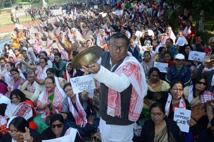 A man plays cymbals as protestors gather during an agiatation against the passing of Citizenship Amendment Bill, in Dibrugarh. (PTI Photo)