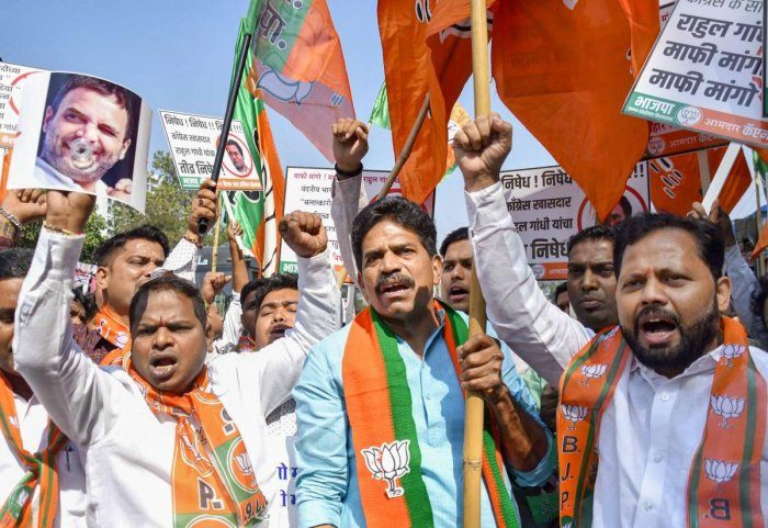 BJP youth party workers protest against Rahul Gandhi outside Congress Office. PTI