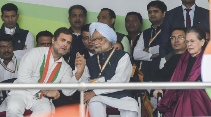 Congress leader Rahul Gandhi and former prime minister Manmohan Singh interact as party President Sonia Gandhi looks on, during party's 'Bharat Bachao' rally at Ramlila Maidan in New Delhi, Saturday, Dec. 14, 2019. (PTI Photo)