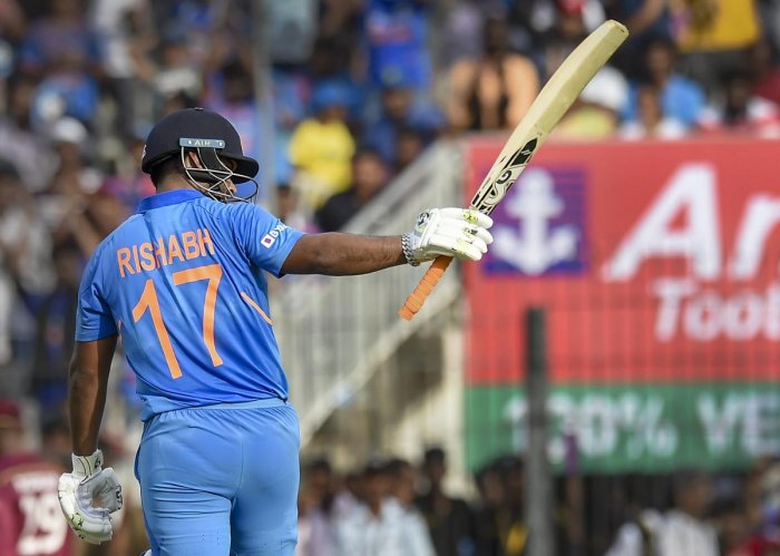 Indian batsman Rishabh Pant raises his bat after completing his half-century during the first One-Day International (ODI) cricket match against West Indies, at MAC Stadium in Chennai. PTI