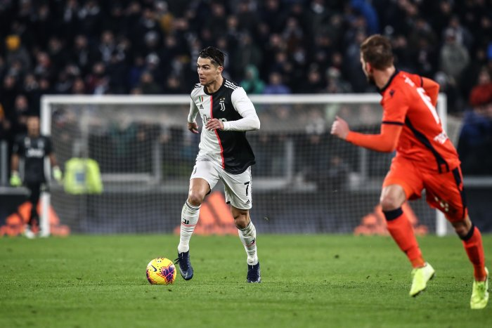 Juventus' Portuguese forward Cristiano Ronaldo runs with the ball during the Italian Serie A football match Juventus vs Udinese. (AFP Photo)