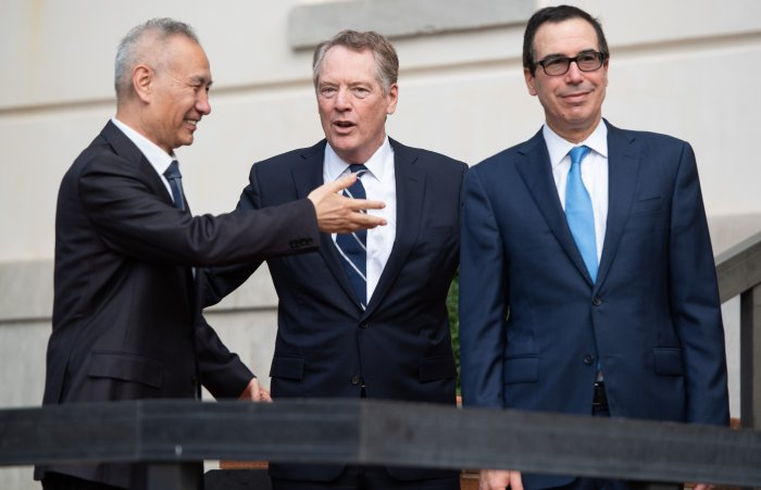 US Treasury Secretary Steven Mnuchin (R) and US Trade Representative Robert Lighthizer (C) greet Chinese Vice Premier Liu He as he arrives for trade talks at the Office of the US Trade Representative in Washington. (AFP Photo)
