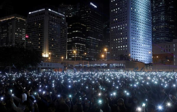 "Anti-government protesters hold up their mobile phones during a ""United We Stand"" rally in Hong Kong, China, December 12, 2019. (Reuters photo)"
