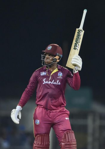 West Indies batsman Shimron Hetmyer raises his bat to celebrate half century during the first One-Day International (ODI) cricket match against India, at MAC Stadium in Chennai, Sunday, Dec. 15, 2019. (PTI Photo)