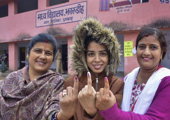 A first-time voter and her relatives show their inked finger after casting votes during the fourth phase of Jharkhand Assembly polls, in Dhanbad. Photo/PTI